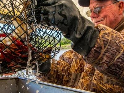 Barry Toups holding crawfish cage