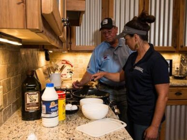 Barry teaching lady to cook at Crawfish Haven Mrs. Rose's Bed and Breakfast