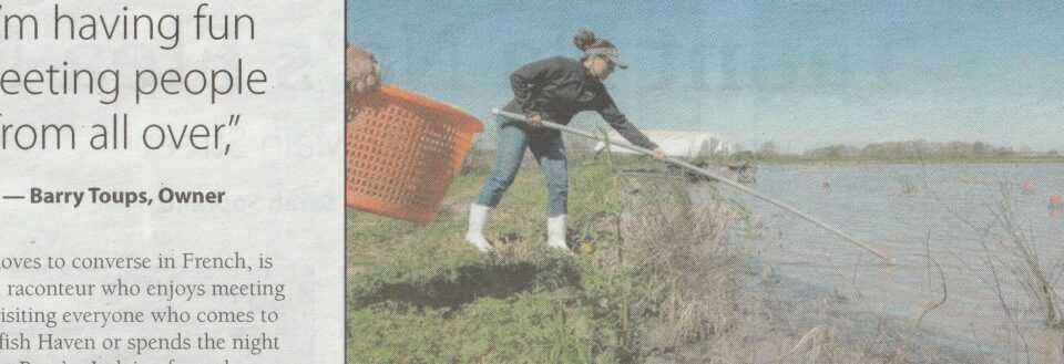 newspaper article of lady crawfishing with hand net