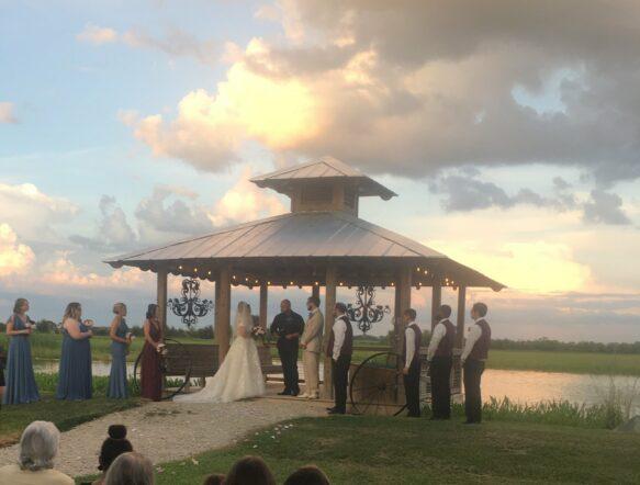 wedding being held in front of gazebo